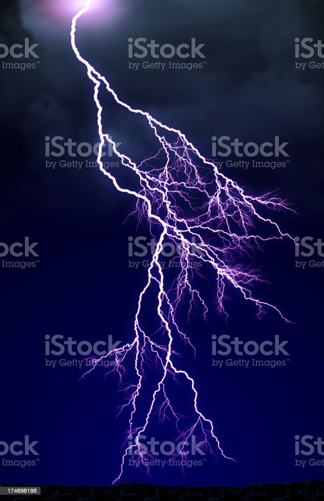Purple lighting against a navy blue sky  stock photo