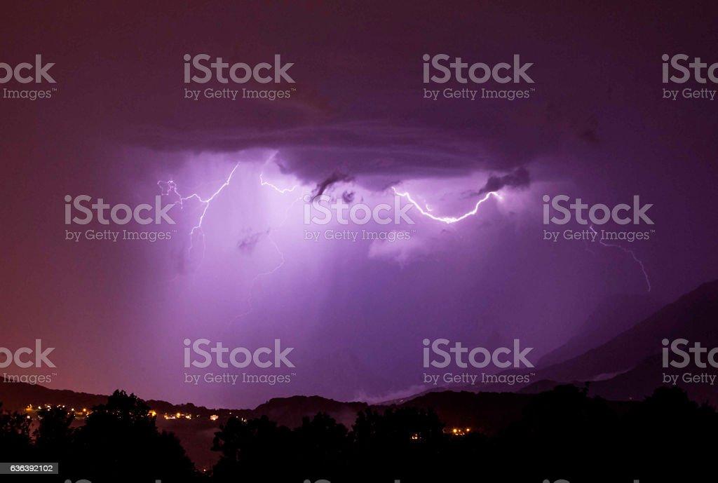 purple lightning, clouds, mountains, summer stock photo
