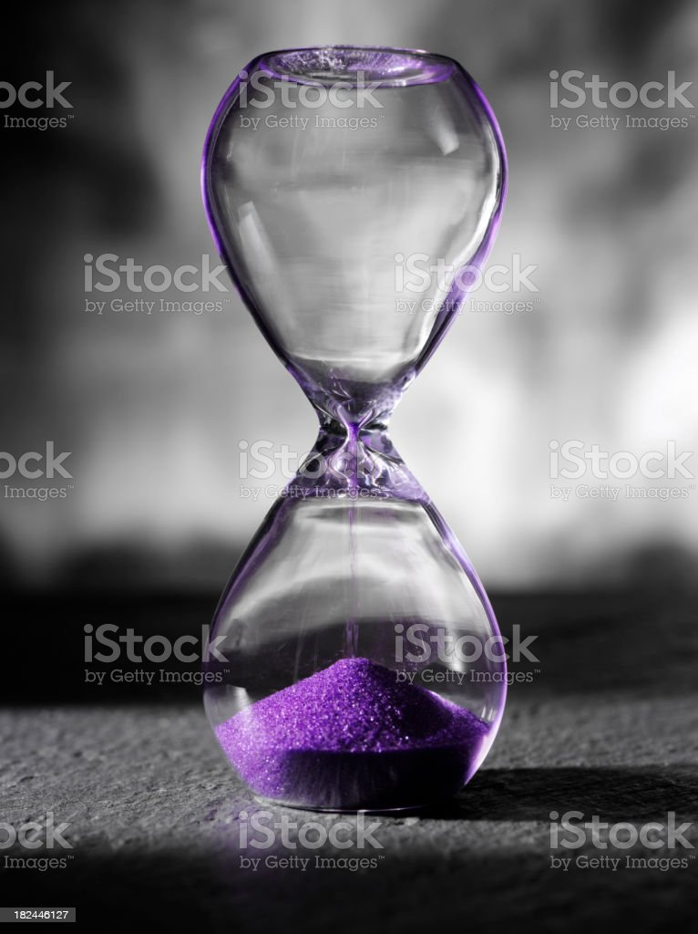 Purple Lights on an Hourglass royalty-free stock photo