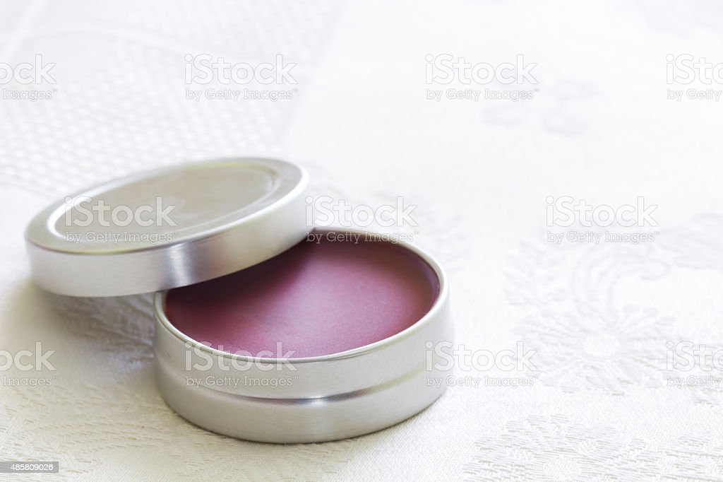 Purple lip balm with beeswax and aroma of grosella stock photo