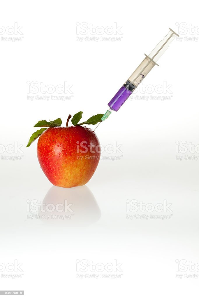 Purple Liquid Being Injected into Red Apple royalty-free stock photo