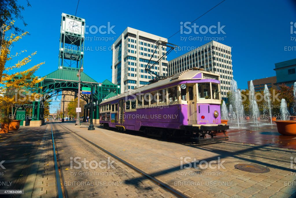 Purple Memphis Trolley car with a fountain in Downtown Memphis stock photo