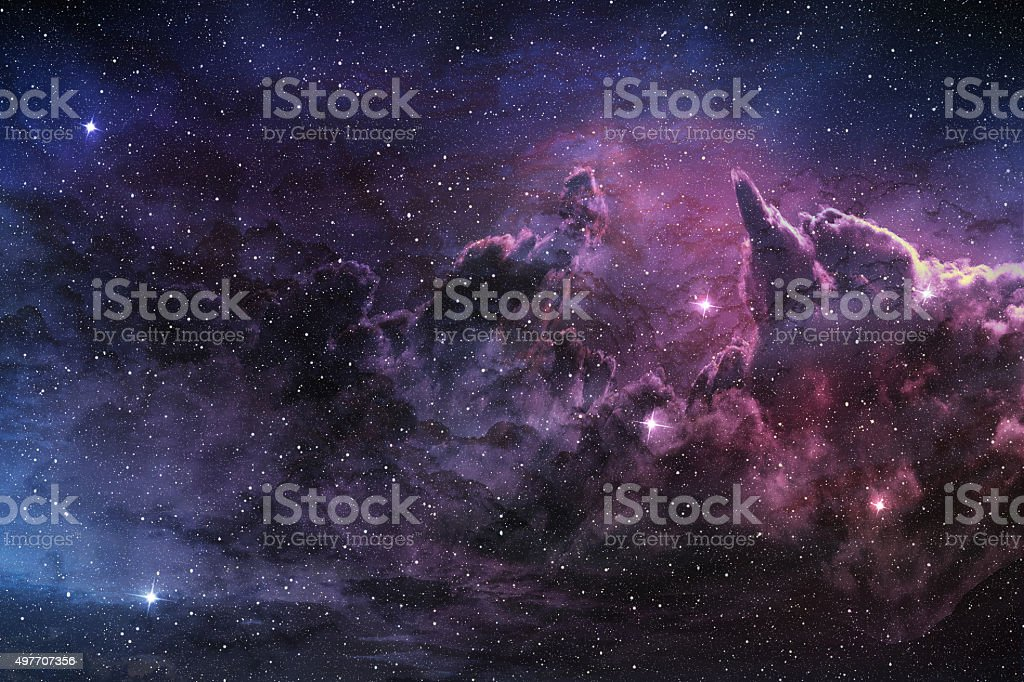 purple nebula and cosmic dust stock photo