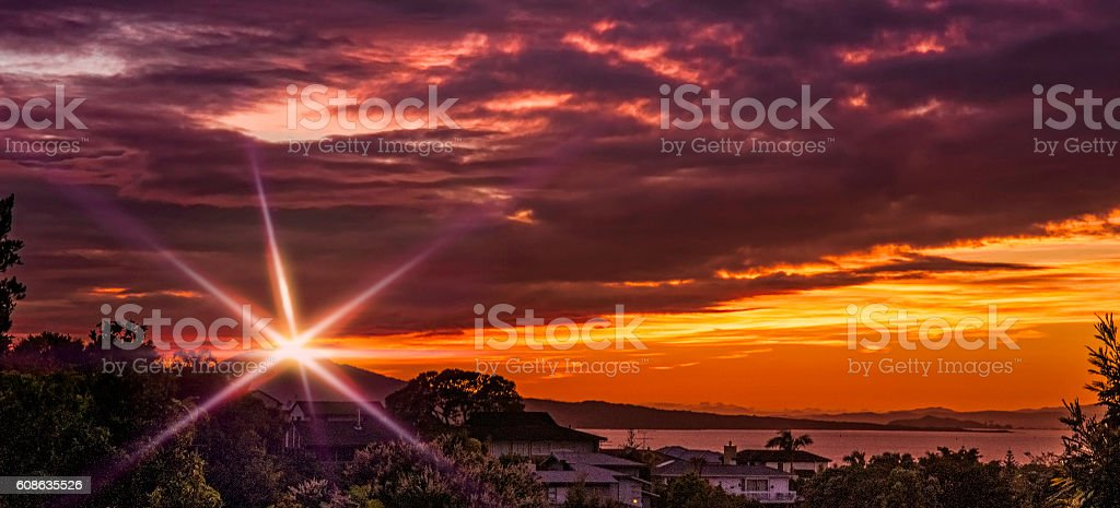 Purple Orange sky with flare stock photo