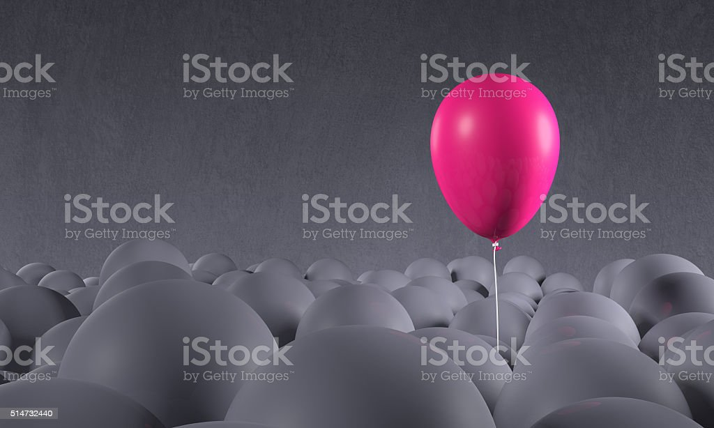Purple pink balloon rising from gray background: individuality, standing out stock photo