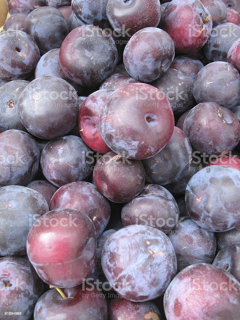 Purple plums at the farmers market royalty-free stock photo