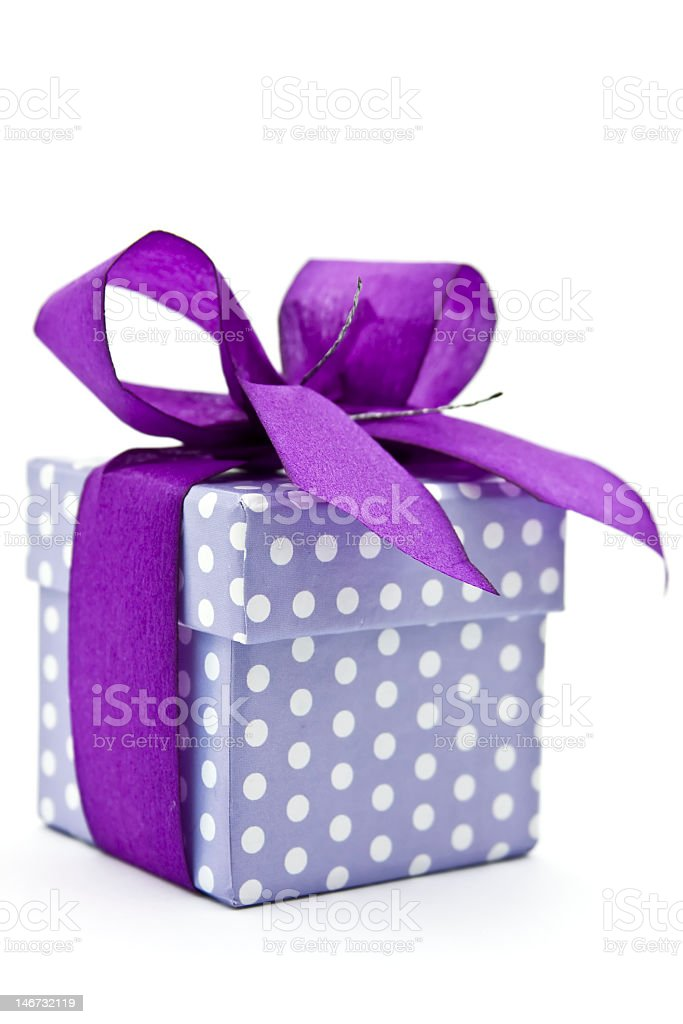 Purple polka dotted gift box tied with purple ribbon royalty-free stock photo