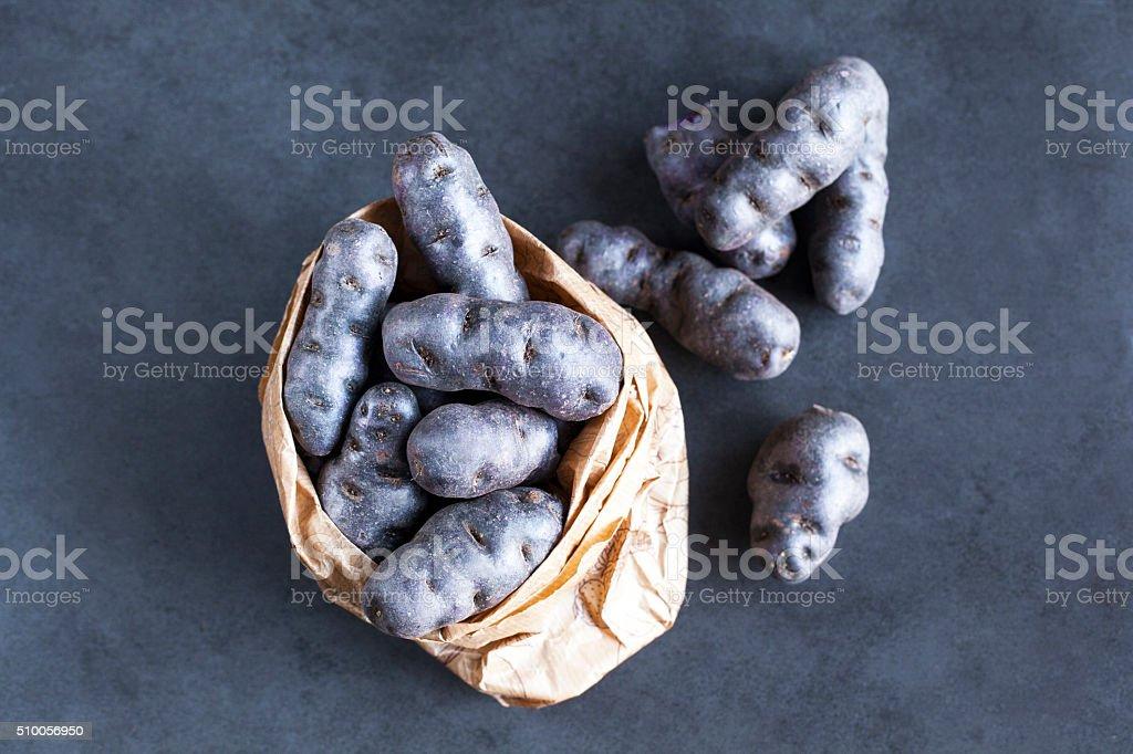 Purple potatos stock photo