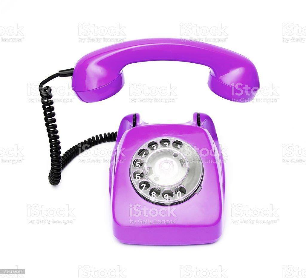 Purple retro telephone isolated on white background. stock photo