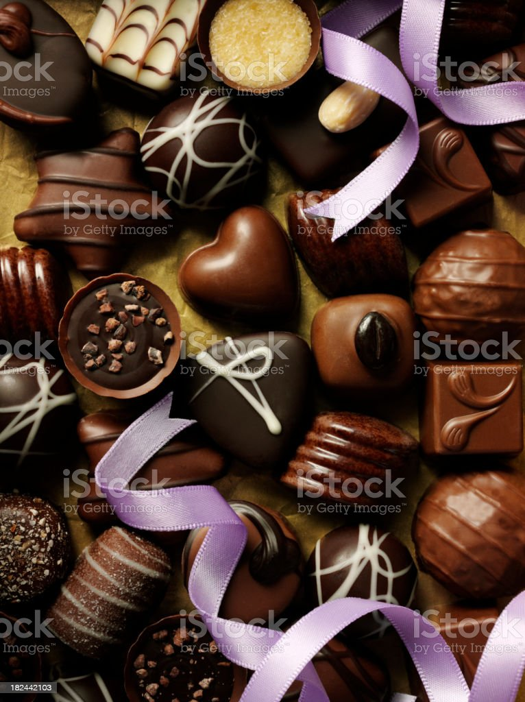 Purple Ribbon and Chocolates stock photo