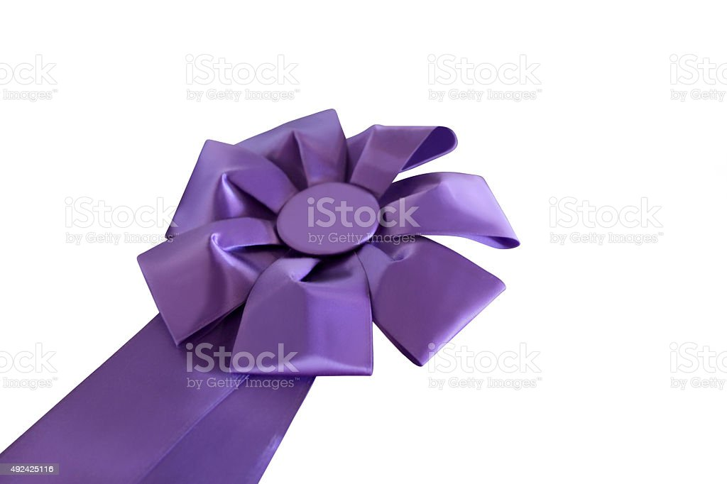 Purple ribbon award isolated on white.  Clipping path. stock photo