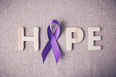 Purple ribbon with HOPE wooden letter, toning, Alzheimer's disea