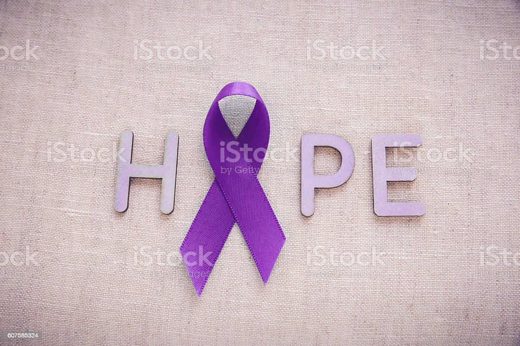 Purple ribbons with HOPE word, Alzheimer's disease, Pancreatic c stock photo