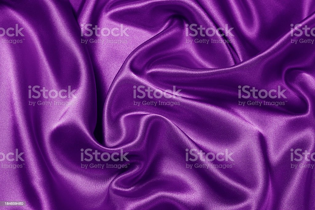 Purple satin scrunched together stock photo