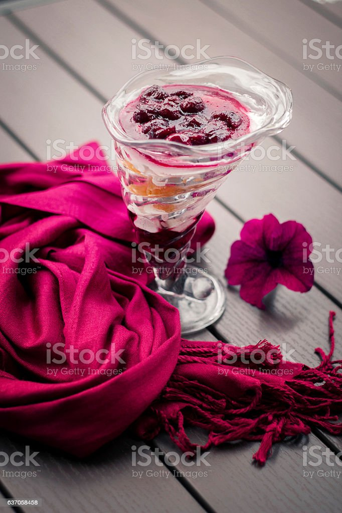 purple scarf and dessert on a table stock photo