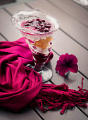 purple scarf and dessert on a table