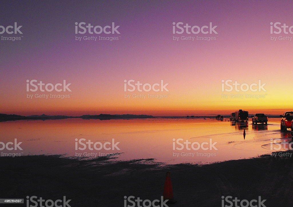 Purple Sky Dawn as Racers Drive onto Bonneville Salt Flats stock photo