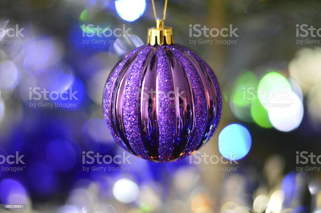 Purple sparkling bauble stock photo