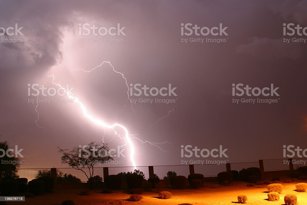 Purple Storm Clouds and Lightning Striking Ground royalty-free stock photo