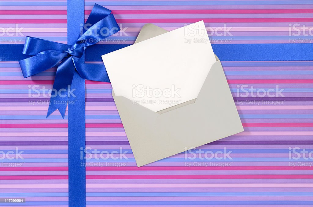 Purple striped gift with blank message card royalty-free stock photo