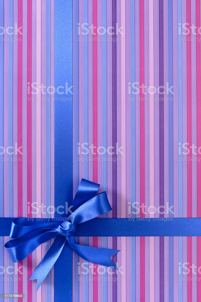 Purple striped gift with blue ribbon (XL) royalty-free stock photo