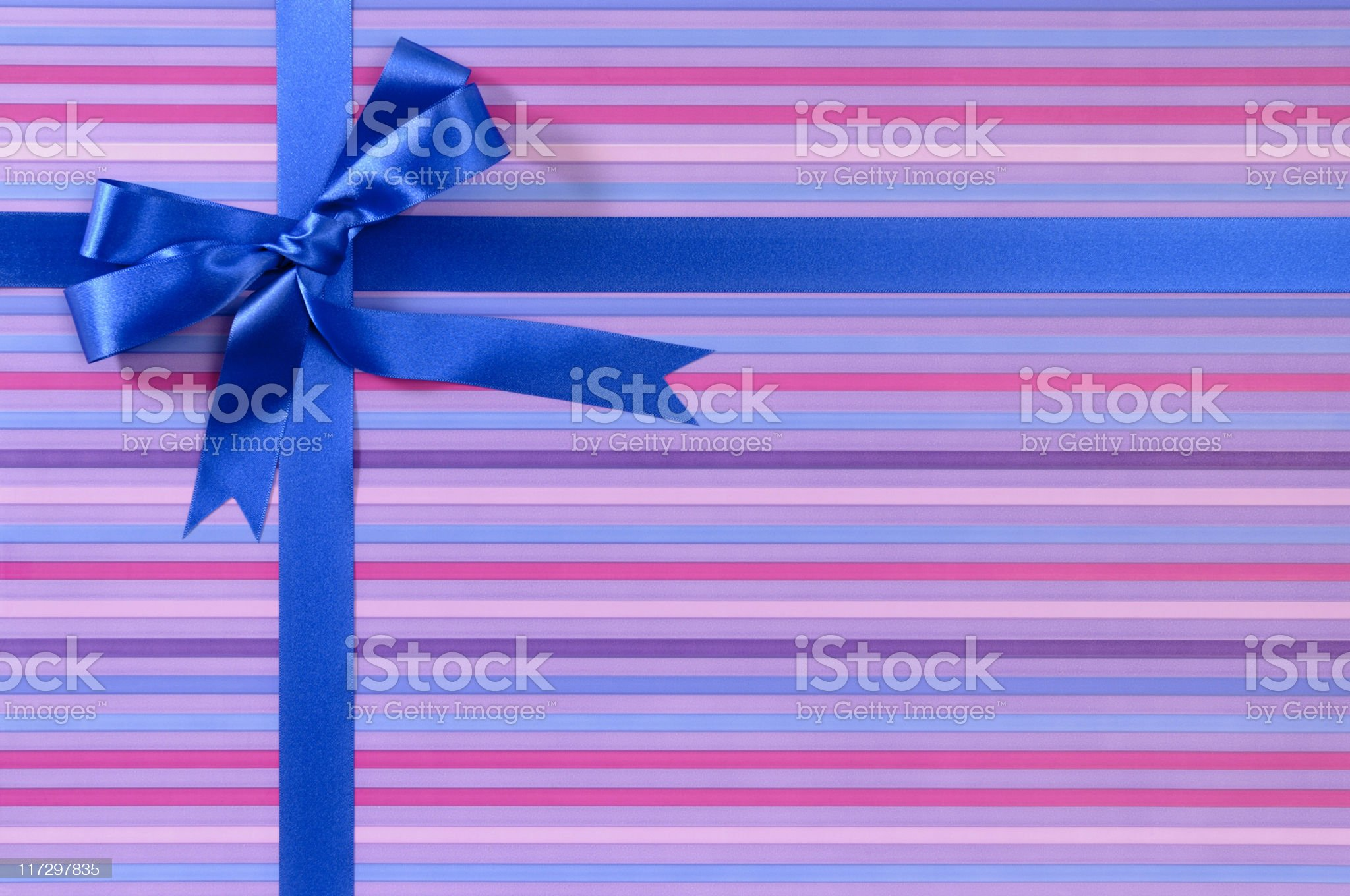 Purple striped gift with blue ribbon royalty-free stock photo