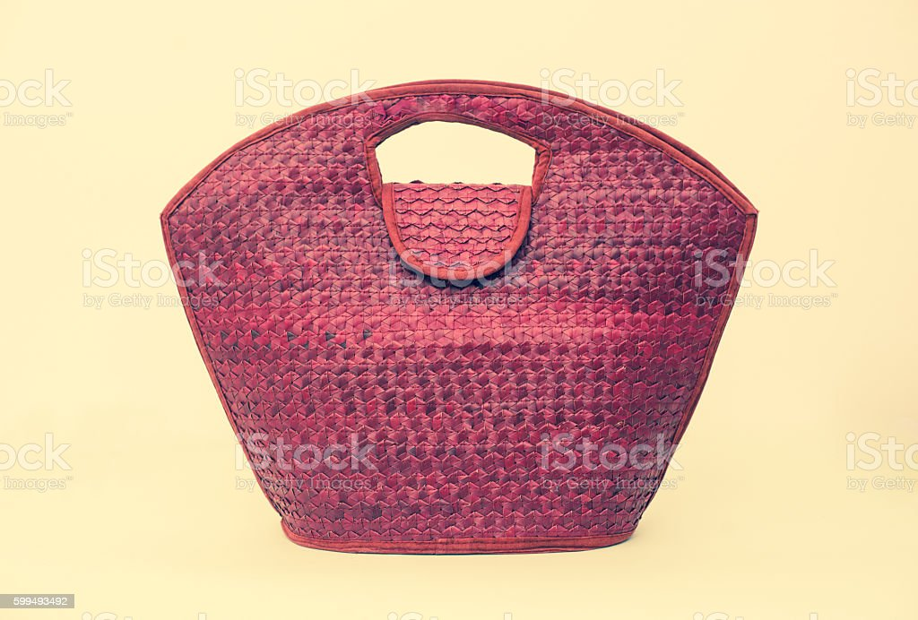 Purple summer female straw bag stock photo