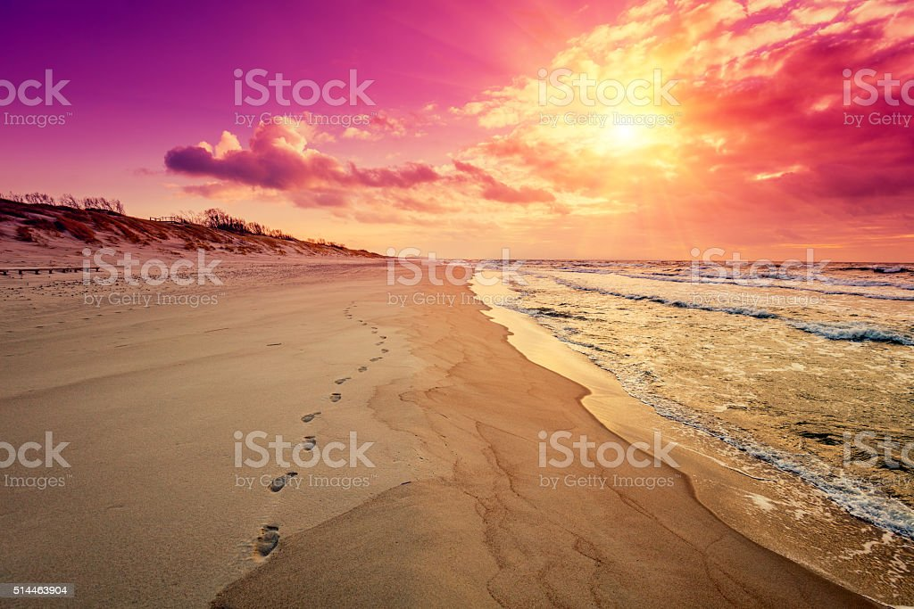 Purple sunrise over sea stock photo