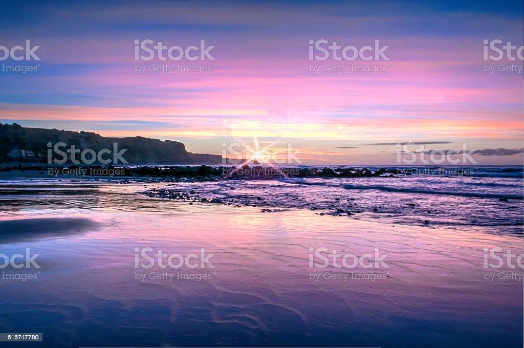Purple sunrise with flare stock photo