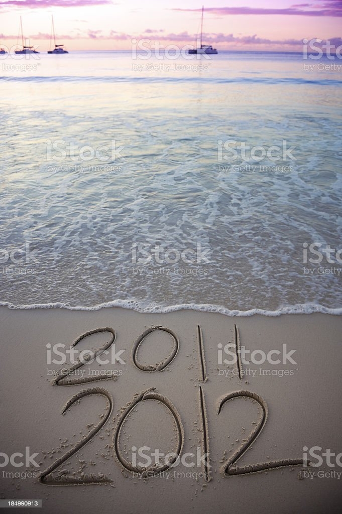 Purple Sunset 2011 2012 Message in Smooth Sand royalty-free stock photo