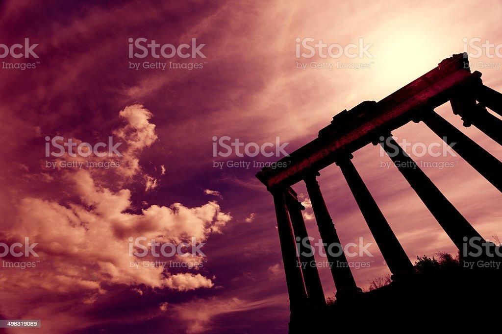 Purple sunset over ancient Temple of Saturn, Roman Forum stock photo