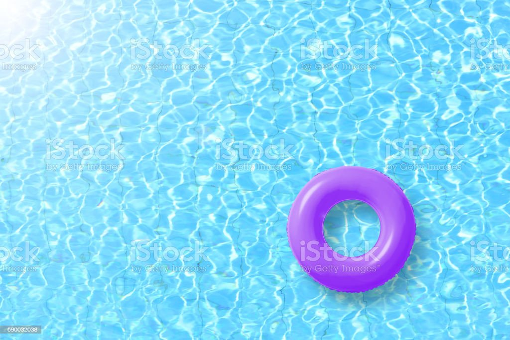 purple swimming pool ring float in blue water and sun bright. concept color summer. stock photo