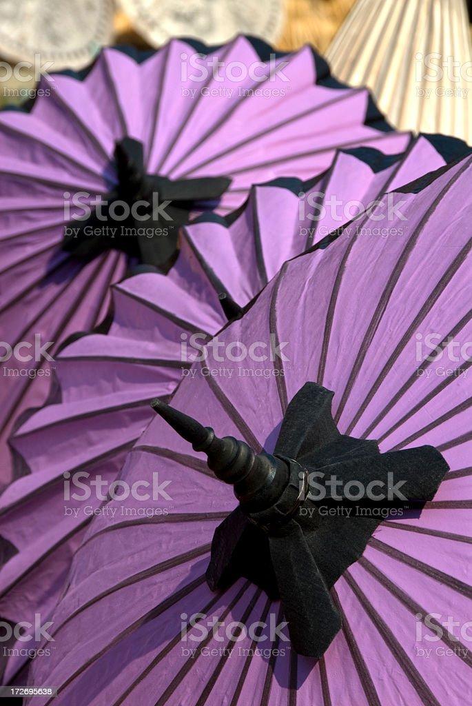 Purple Umbrellas Drying stock photo