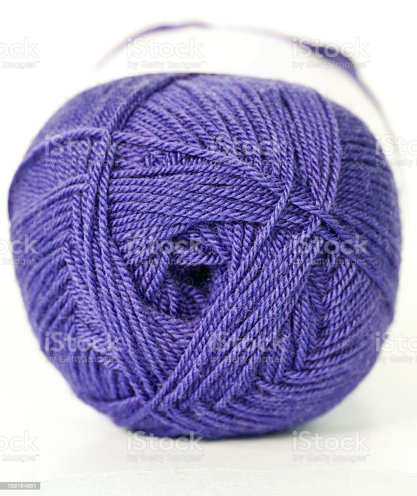 purple wool yarn skein at the white background royalty-free stock photo
