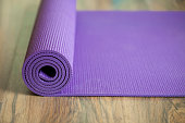 purple yoga mat in the exercise class