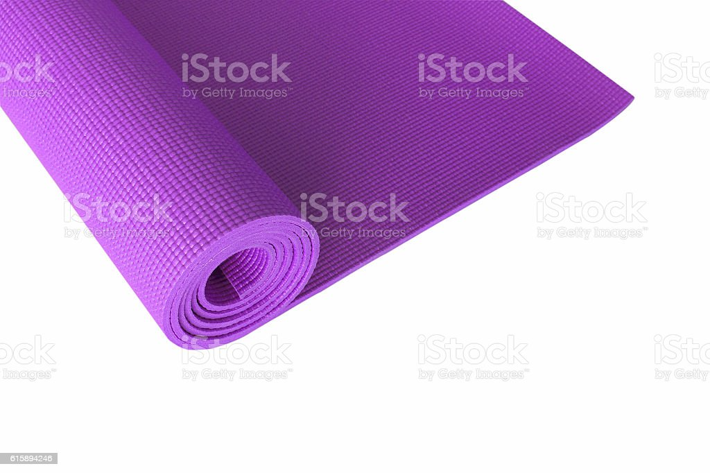 Purple yoga mat isolated on white. stock photo