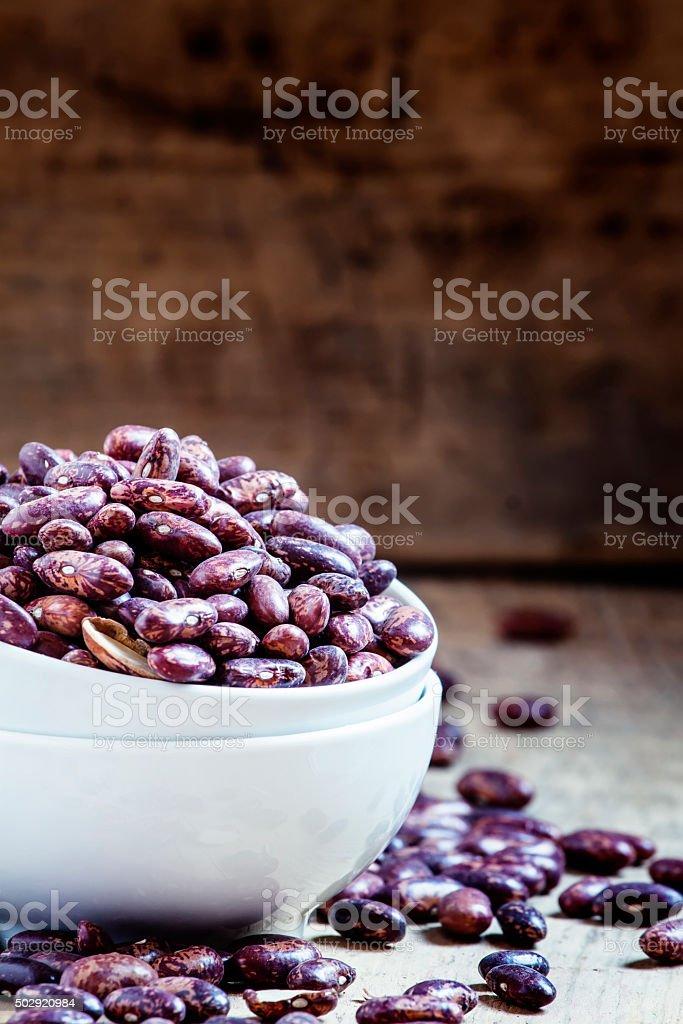Purple-brown dry beans stock photo