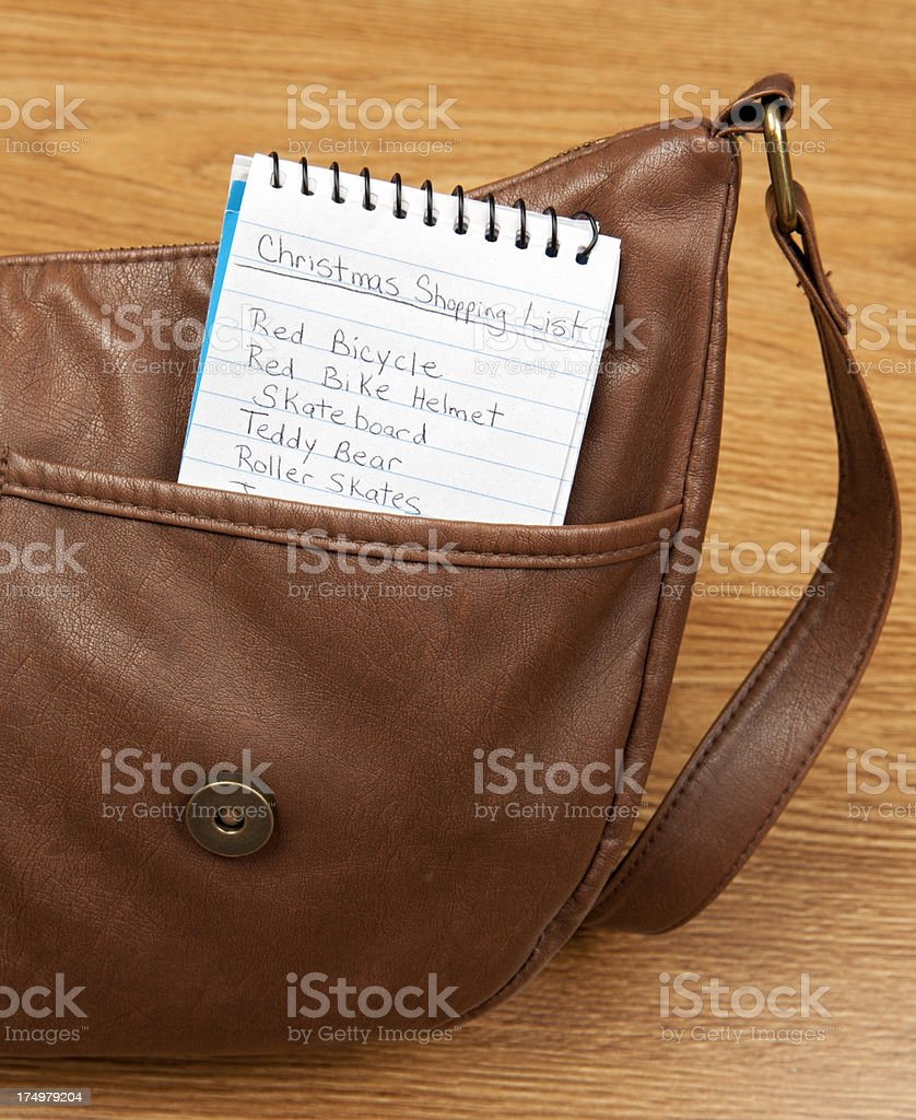 Purse with Christmas Shopping List of Toys stock photo