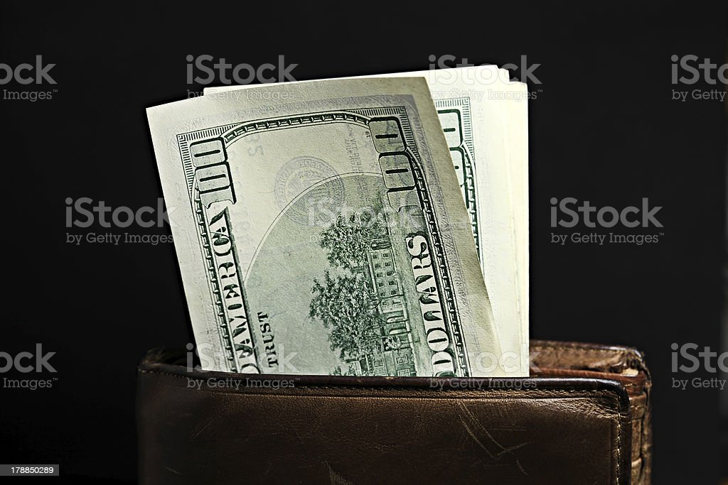 Purse with pack of dollars royalty-free stock photo