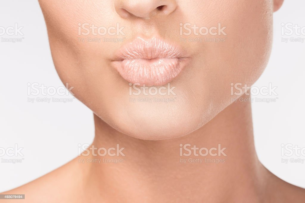 Pursed lips Beautiful sensual lips    Beauty portrait  Women stock photo