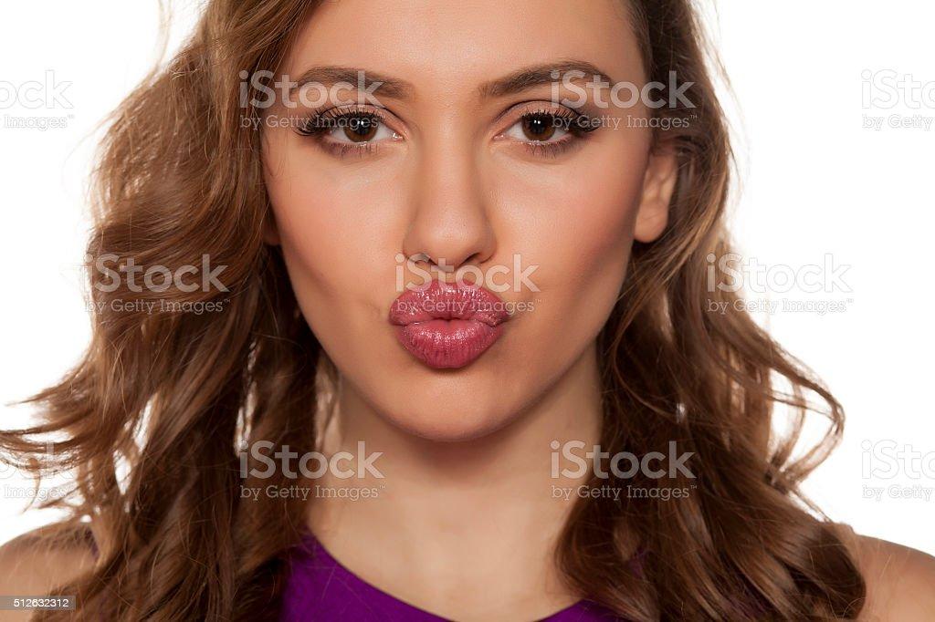 pursed lips stock photo