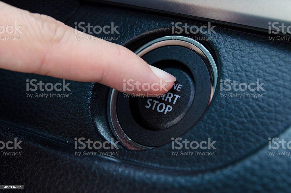 Push an engine start button stock photo