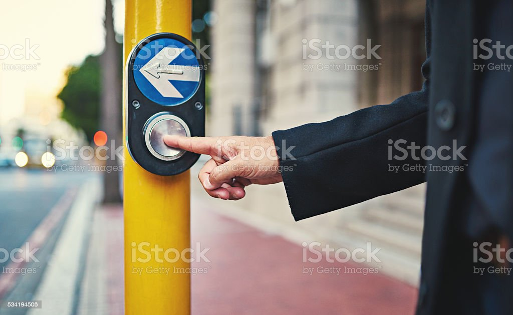 Push for a pedestrian's right of way stock photo