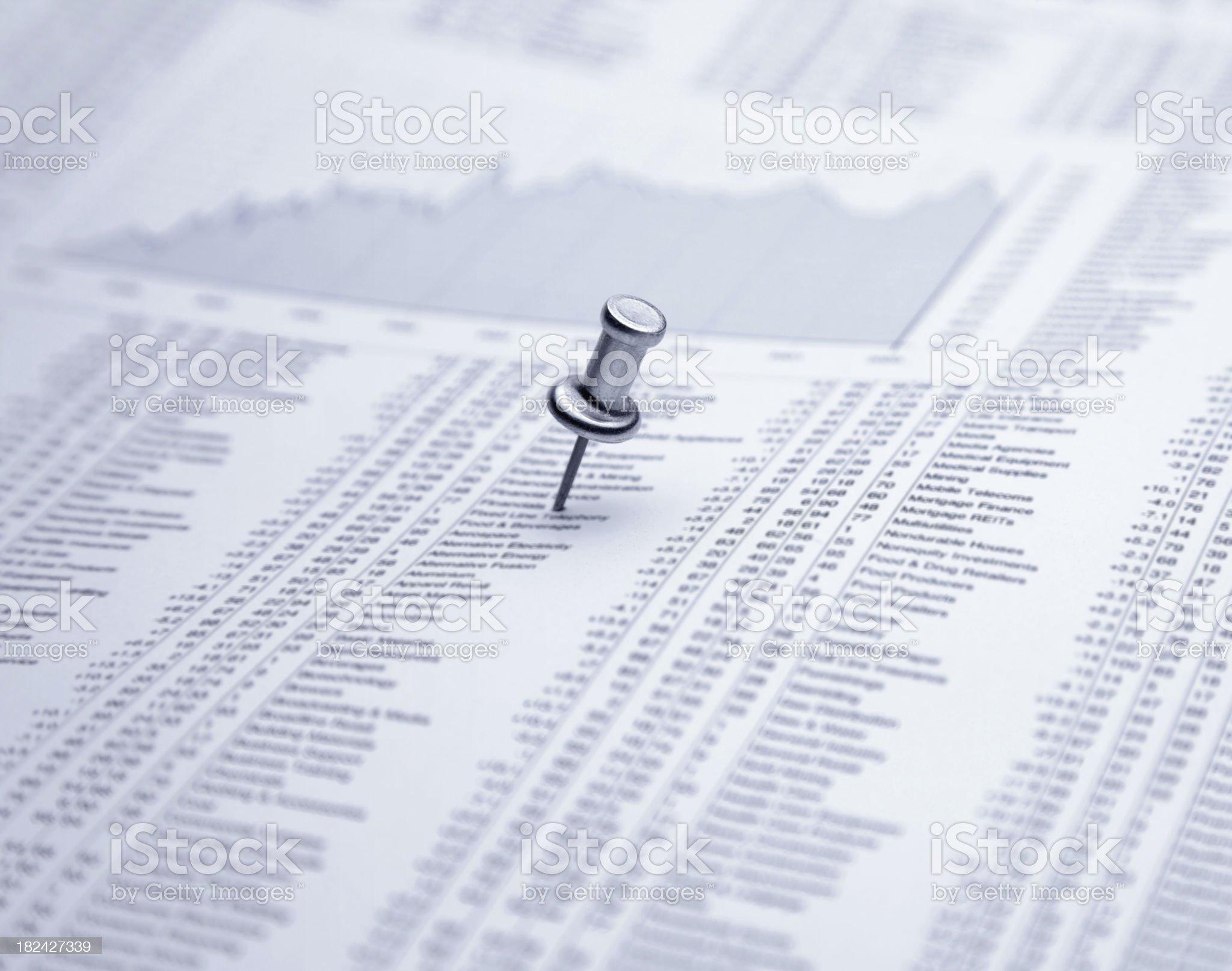 Push pin on financial newspaper royalty-free stock photo