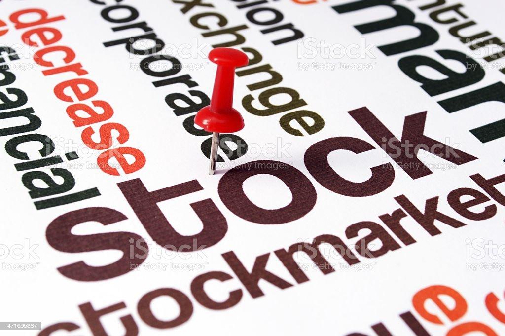 Push pin on stockmarket text royalty-free stock photo