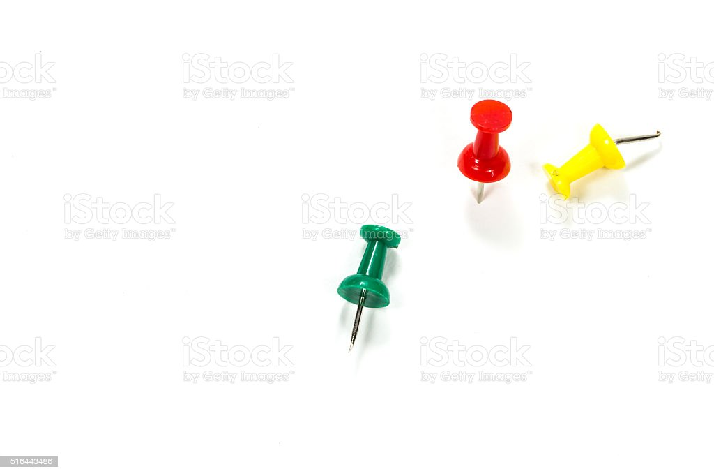 Push pin on white paper stock photo