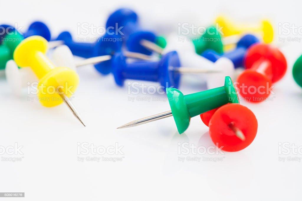 Push pins isolated on white background stock photo