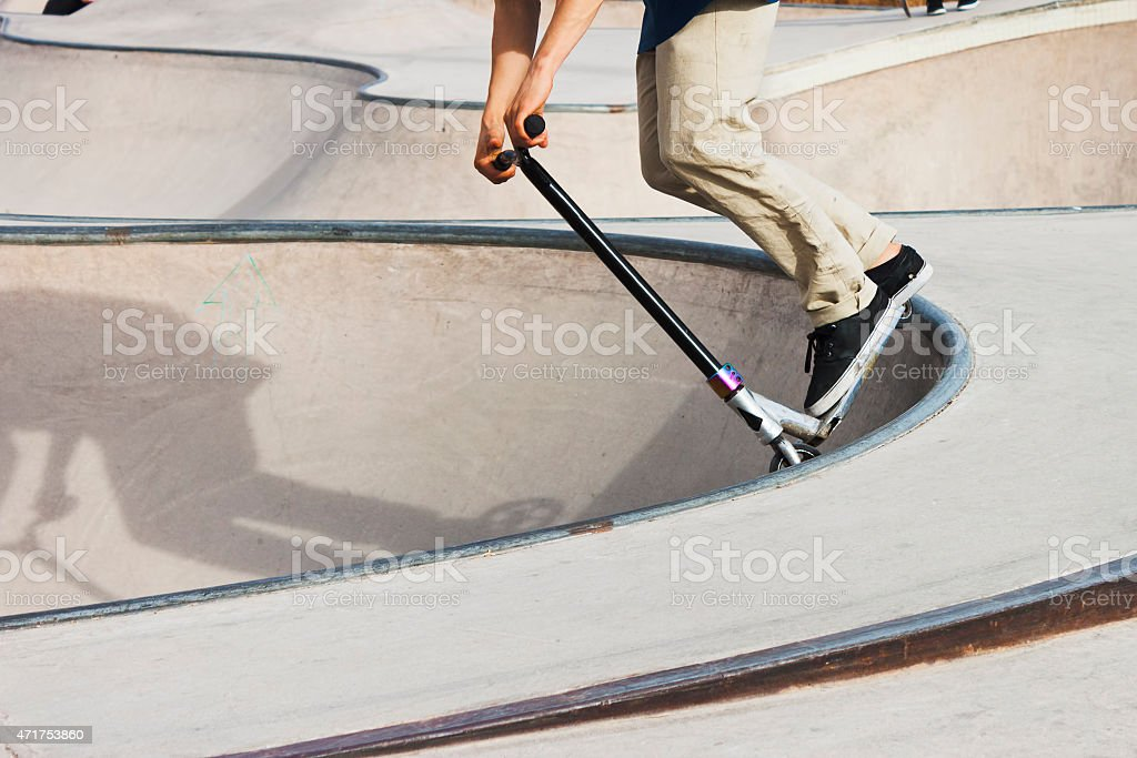 Push scooter boy in skate-park stock photo