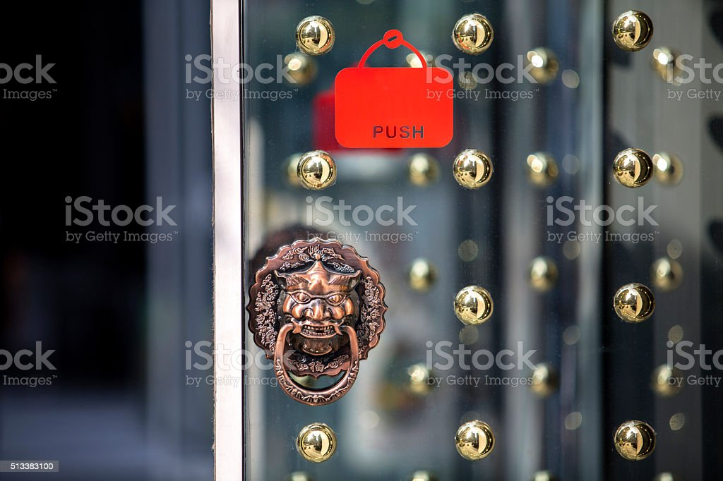 push sign on glass door of a shop stock photo