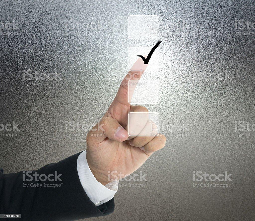 Push tick on lists screen stock photo